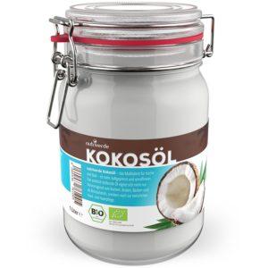 Kokosöl im Glas vor weissem Hintergrund